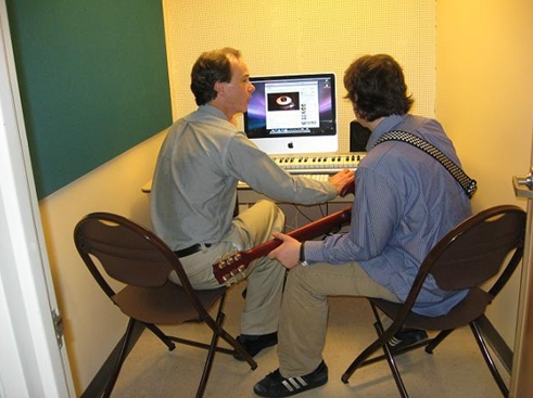 Music faculty member Eric Sinclair with a student in the Listening Room