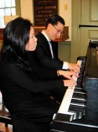 Pianists Jung Mi Lee and Jon Sakata.